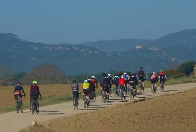 Group of gravel bikers cycling through a track in the Empordà