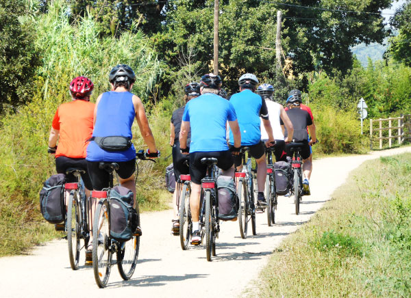 Cycling with friends on the Greenway of El Carrilet