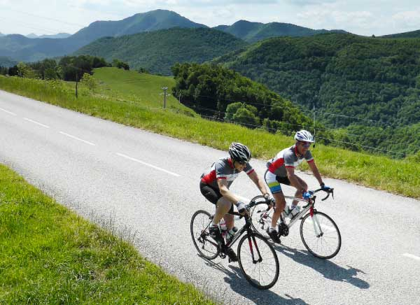 Road bikers cycling in the Pyrenees