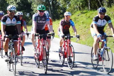 Road bikers group cycling in Girona